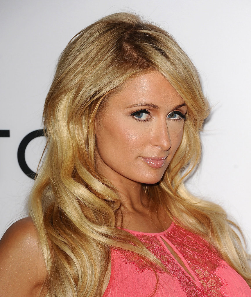 Paris Hilton was the typical blond bombshell with a head of voluminous waves and a bronzed complexion.