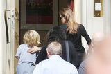 Angelina Jolie showed one of her children the way into a coffee house in Berlin.
