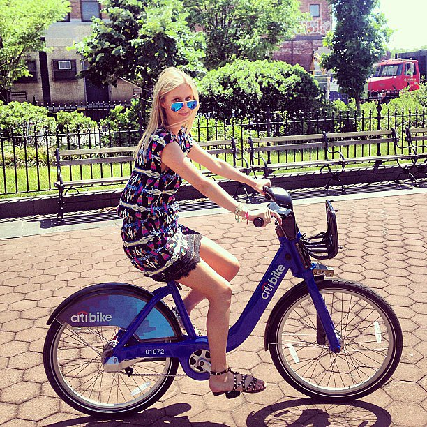 Nicky Hilton looked cute and summery while trying out NYC's latest form of transportation, CitiBike — check out her mirrored shades! Source: Instagram user nickyhilton