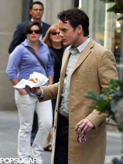Anton Yelchin was eating on set during the filming of 5 to 7 in New York on Wednesday.