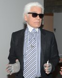 """I think tattoos are horrible. It's like living in a Pucci dress full-time. If you're young and tight, maybe it's OK, but. . .""  — Karl Lagerfeld on tattoos, according to Vogue UK. Source: Billy Farrell/BFAnyc.com"