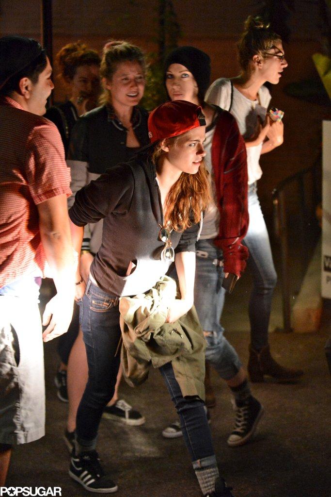 Kristen Stewart wore a red baseball hat.