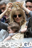 Sienna Miller tried on flower crowns at the flea market.