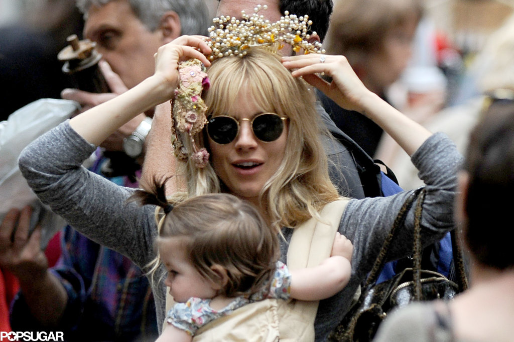 Sienna Miller tried on a flower crown with baby Marlowe.