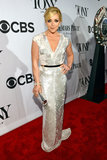 Jane Krakowski shimmered in a silver sequined Escada number.