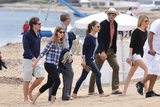 Princess Beatrice and her boyfriend, Dave Clark, kicked off the weekend on a yacht off the coast of Antibes, France, and on Saturday, they joined Mila Kunis and a shirtless Ashton Kutcher for a Saint-Tropez visit.