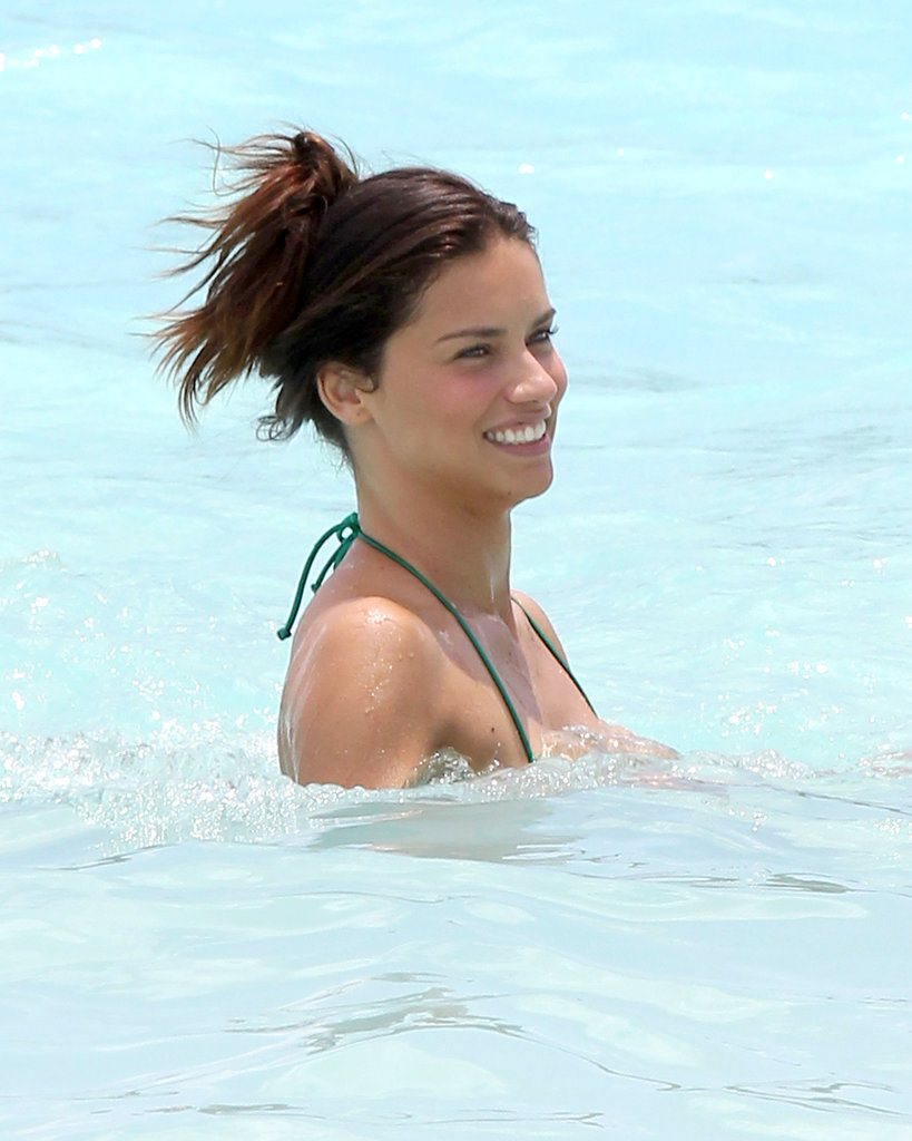 Adriana Lima has mastered the ideal beach style for long hair. Take note, and casually whip your hair up into a clip before you surf the waves.