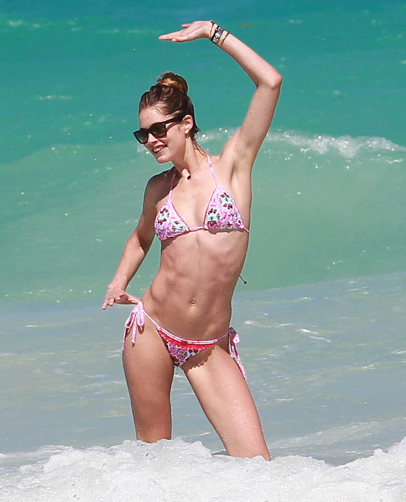 Model Doutzen Kroes was obviously having a good time in the surf with her hair pulled back into a wet topknot.