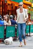 Olivia walked her dog in a classic-cum-cool Summer ensemble. Up top she wore a silky white tank and matching blazer, then added ripped jeans and tan ballet flats.