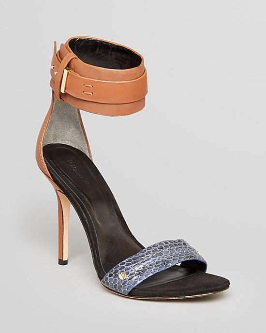 The tan leather and bit of exotic blue make this pair of Rachel Roy Osana high-heel sandals ($250) a standout in all the right ways.
