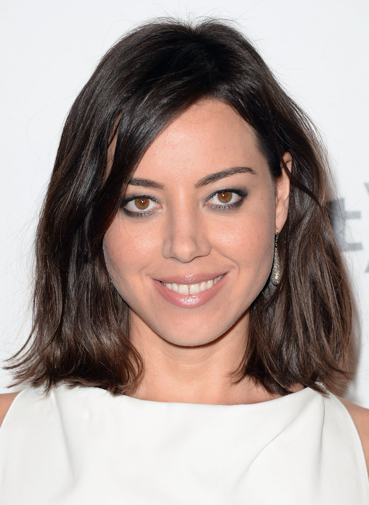 Parks and Recreation actress Aubrey Plaza paired her textured lob with a metallic smoky eye.