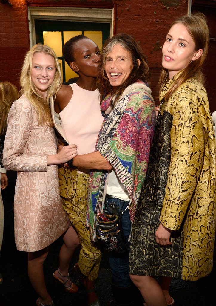 Models with Steven Tyler at Stella McCartney's Resort 2014 presentation.