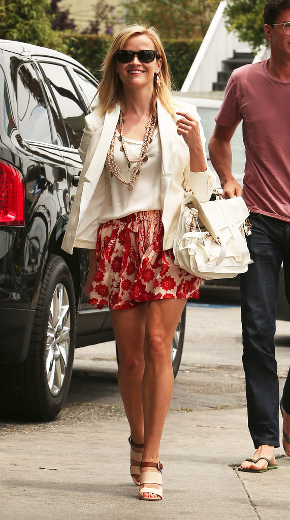 Reese Witherspoon's floral skirt pepped up her white blazer and white Proenza Schouler bag during a lunch in Malibu.
