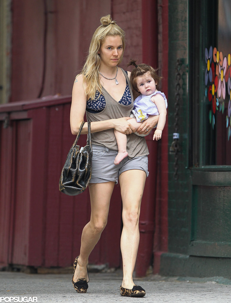 Sienna Miller carried Marlowe for a walk around the West Village in NYC.