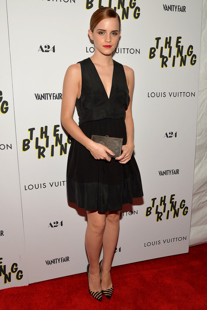 For The Bling Ring's screening in NYC, Emma Watson spiced up her little black dress with a Salvatore Ferragamo box clutch, striped pumps, and Monique Péan jewels.
