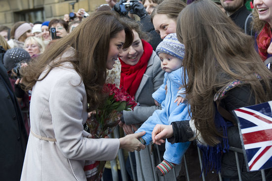 Kate Middleton was still keeping her pregnancy a secret on Nov. 28, 2012, when she was joined by Prince William to visit their namesake town, Cambridge.