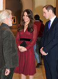Kate Middleton smiled with artist Paul Emsley and Prince William when she attended an unveiling of her official portrait at the National Portrait Gallery on Jan. 11.
