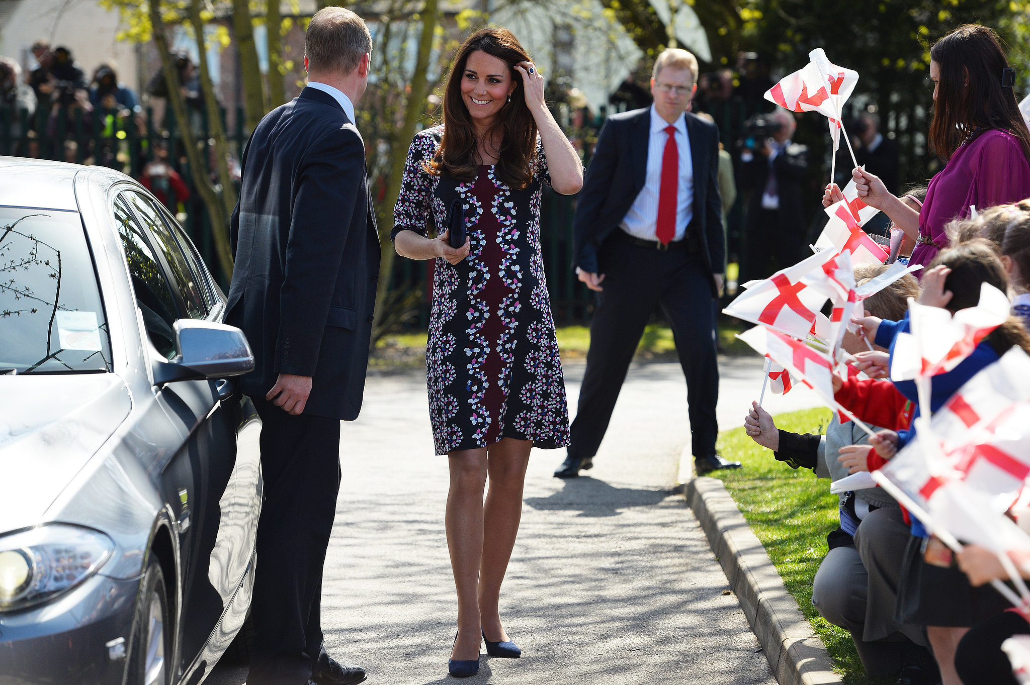 In April 2013, Kate was all smiles when she dropped by the Willows Primary School in Manchester, England, in a patterned Erdem dress.