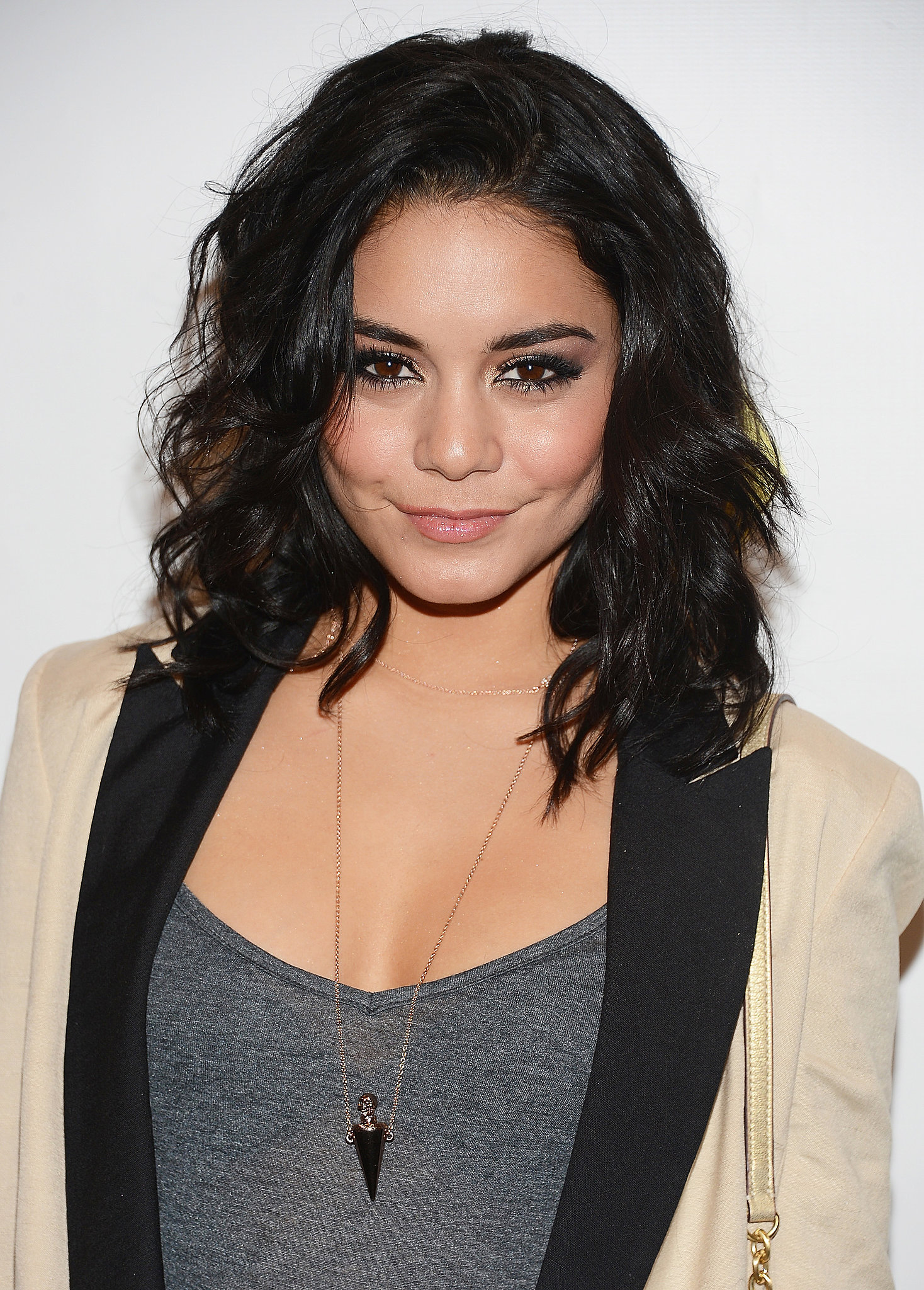 Take a styling cue from Vanessa Hudgens, and play up your natural texture. You can enhance your waves with a quick hit of a curling iron and don't worry about a part — j