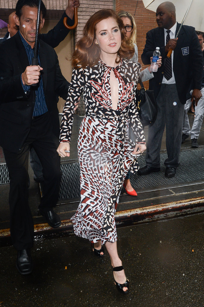 On her way into Katie in NYC, Amy showed off a gorgeous Diane von Furstenberg printed dress with a sexy keyhole. She finished with black patent Christian Louboutin sandals that were equally smashing.