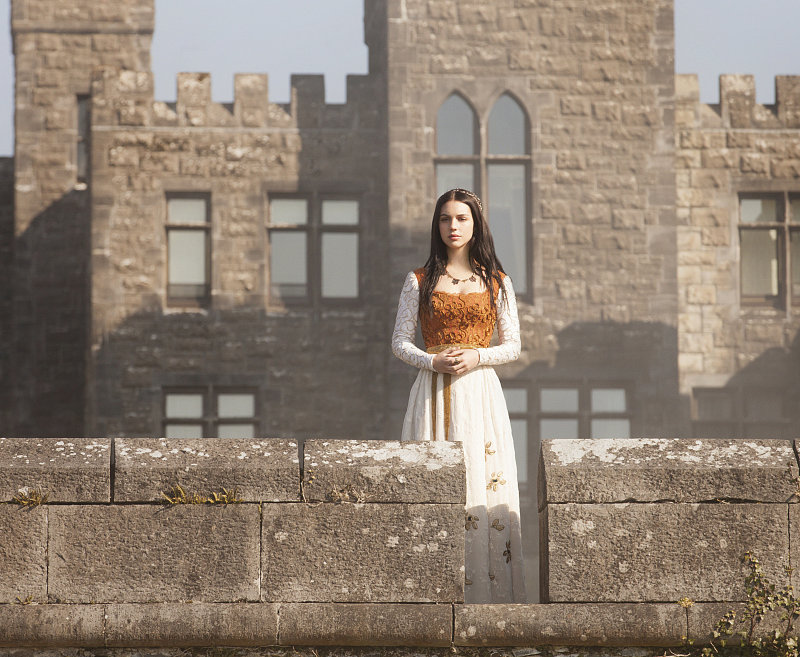 Mary takes some time to reflect outside the castle.