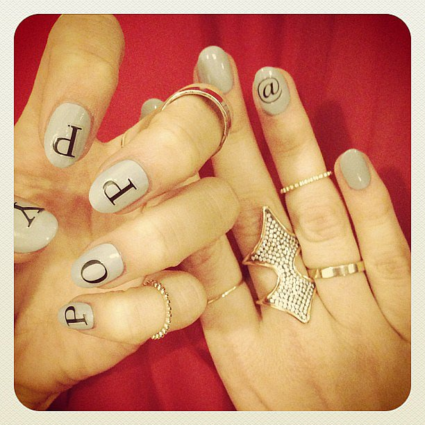 Poppy Delevingne showed off some very cool monogrammed nails. Source: Instagram user poppydelevingne
