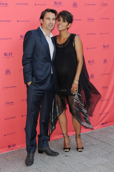 Pregnant Halle Berry and Olivier Martinez showed affection at the Champs-Élysées Film Festival in Paris.