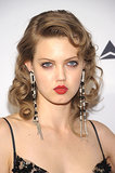 Model Lindsey Wixson went for full-on vintage vixen with a head of curls, a crimson lipstick, and bedroom eyes.