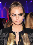 While attending a DKNY event in London, Cara Delevingne had an edgy vibe going with her dark smoky eyes