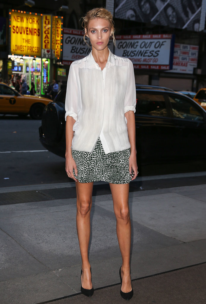 Anja Rubik put her long limbs on display in a printed miniskirt in Poland.