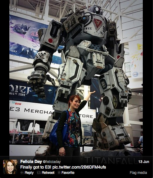 Geek & Sundry's Felicia Day says hello to a tall Titan at the E3 gaming expo in Los Angeles.