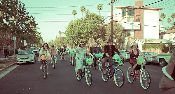 Parade on Wheels Instead of a limo or dealing with valet parking, take a cue from this wedding and rent bikes for all your guests to head to the reception from the ceremony! Photo by Sights & Sounds via Style Me Pretty