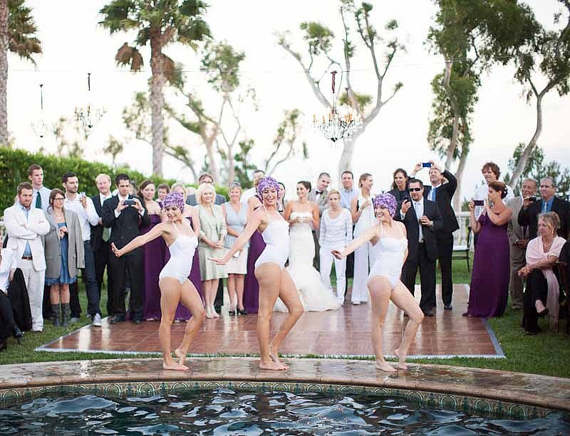 Sync Up If you're guests aren't willing to jump in the pool, they can still enjoy it by watching synchronized swimmers perform. Definitely not your typical reception entertainment! Photo by Annie McElwain via Style Me Pretty