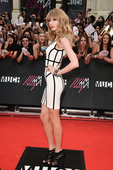 Taylor Swift wore a black and white dress.