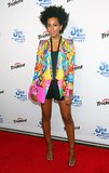 Knowles tempered her colorful Roberto Cavalli blazer with black basics and clear sandals, then turned up the heat with a neon CC Skye clutch.