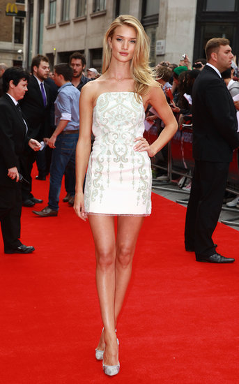 At the London premiere of Hummingbird, Rosie Huntington-Whiteley matched a white, strapless, embroidered Emilio Pucci minidress with Casadei pumps.
