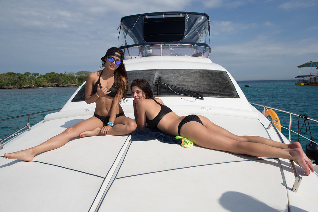 Vanessa Hudgens and Ashley Greene boarded a boat before taking off to learn how to surf in Bali, Indonesia, in June.