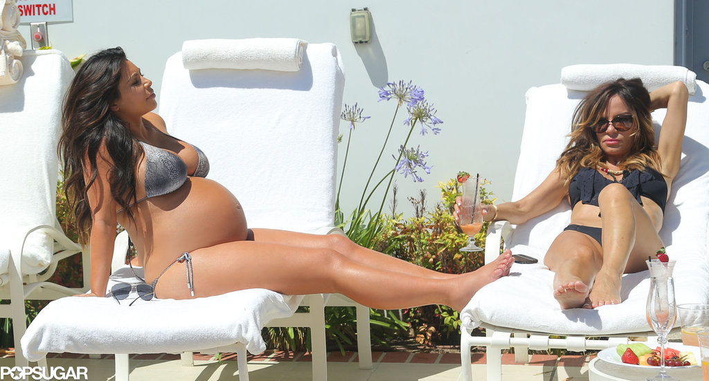 Kim Kardashian soaked up the LA sun in a bikini just days before giving birth to a girl.