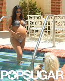 Kim Kardashian chatted with a friend while at an LA pool in June.