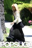 Rachel Zoe wore a black maxi dress.
