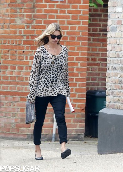 Kate Moss took a wild stroll in London wearing a leopard-print sweater with black skinny jeans.