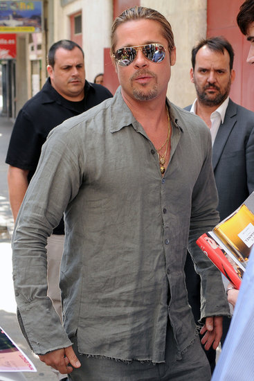 Brad Pitt wore a gray shirt and matching pants.