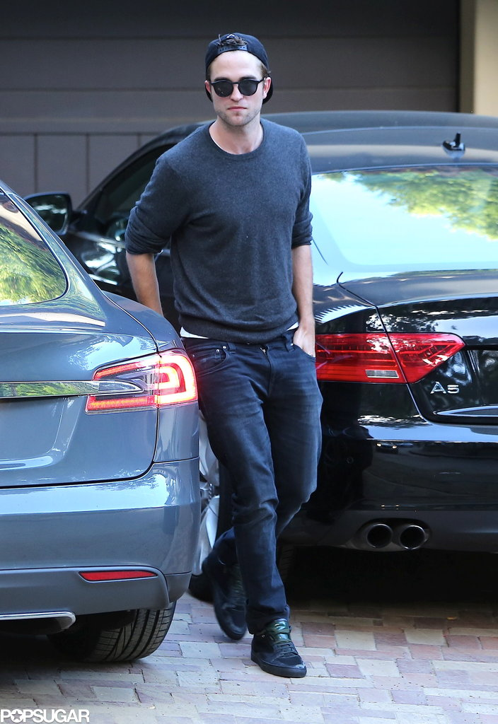 Robert Pattinson walked into his home.