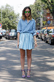 A chambray button-down played right into the baby-blue hues of her skirt — while a pair of green mirrored shades were an awesome counter.