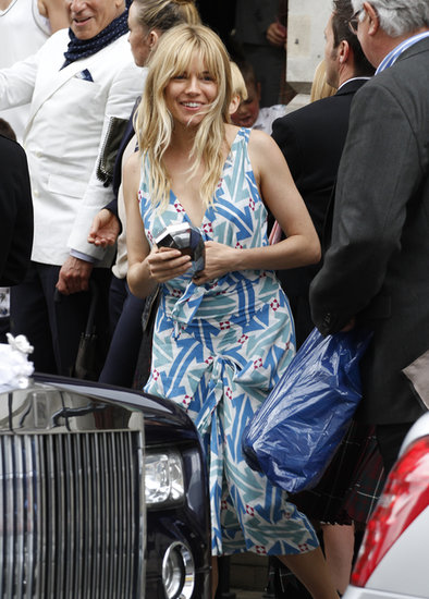 Sienna Miller struck a balance between dressy and laid-back at a London wedding in June. Follow her lead and don a fancy printed dress, but keep your tresses perfectly tousled.