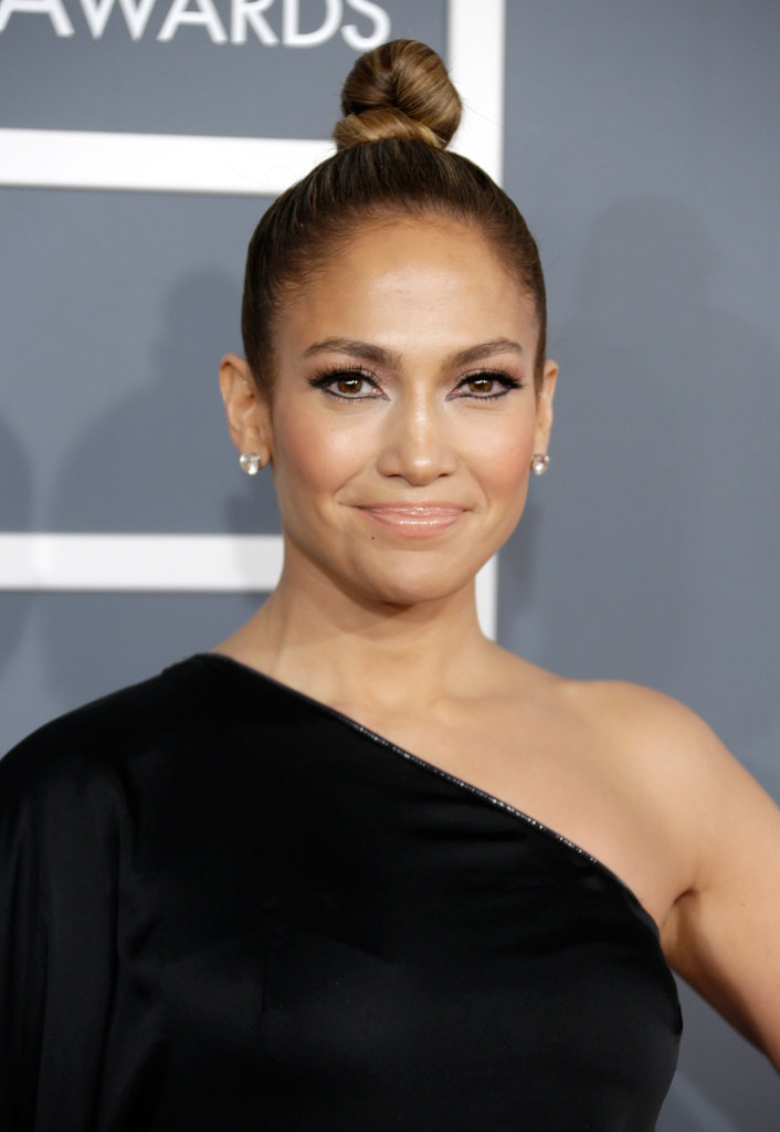 At the Grammy Awards, Jennifer Lopez went for a twisted and twirled topknot that put the focus on her exaggerated eye makeup.