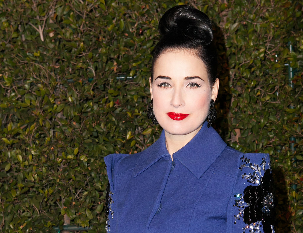 It's rare you see Dita Von Teese in anything other than vintage waves, but this updo modernises her retro style considerably.