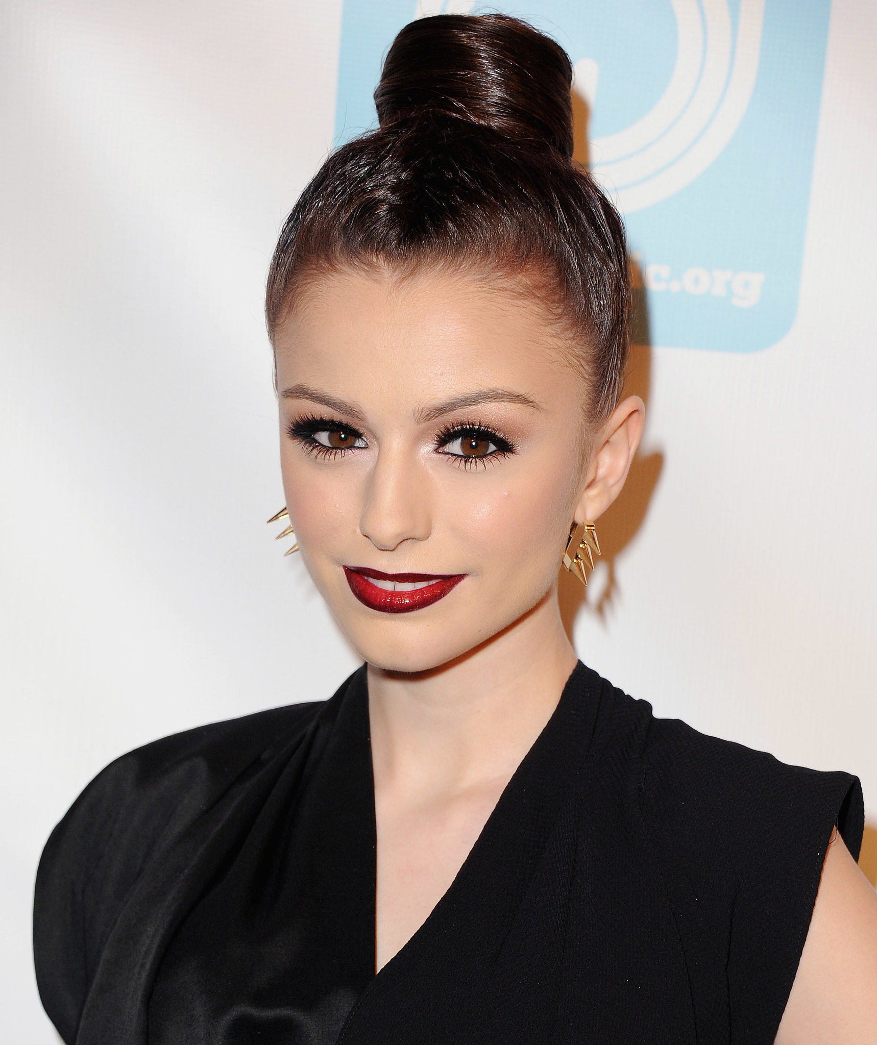 This high bun, as spotted on singer-songwriter Cher Lloyd, has a cylindrical shape that's quite unique.
