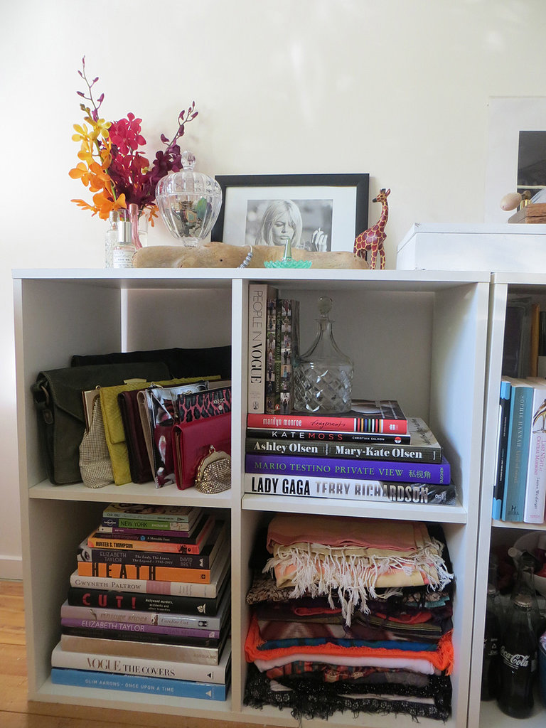 I like to mix my accessories in with other decorative pieces in my room — here my purses, clutches and scarves mingle with a few of my favourite coffee tables books, while some jewellery rests on top.