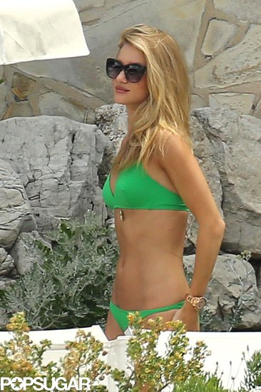 We're green with envy over Rosie Huntington-Whiteley's bright bikini — not to mention her killer tan and perfect beach spot in the South of France.